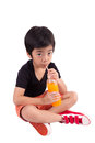 Portrait of happy little boy drinking orange juice isolated ove over white background Stock Images