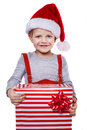 Portrait of a happy little boy holding a new christmas gift studio isolated over white background Royalty Free Stock Photo