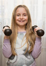 Portrait of happy little girl with dumbbells Royalty Free Stock Photo