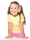 Portrait of happy little girl leaning on a table Royalty Free Stock Photo