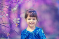 Portrait of happy little girl in the park in spring Royalty Free Stock Photo