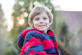 Portrait of happy little kid boy in red jacket, outdoors Royalty Free Stock Photo