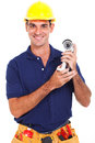 Portrait happy male cctv installer holding camera over white background Stock Images