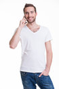 Portrait of happy man calling by mobile in casuals isolated on white concept communication Stock Photos