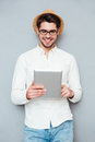 Portrait of a happy man in eyeglasses using tablet computer Royalty Free Stock Photo
