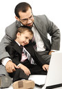 Portrait of a happy man and his son working on laptop Royalty Free Stock Photo