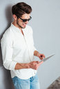 Portrait of a happy man in sunglasses using tablet computer Royalty Free Stock Photo
