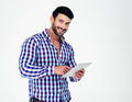 Portrait of a happy man using tablet computer Royalty Free Stock Photo