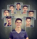 Portrait of a happy masked young man expressing different emotions Royalty Free Stock Photo