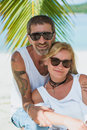 Portrait of happy mature couple at the beach Royalty Free Stock Photo