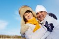 Portrait of happy mature couple in winter clothes looking at camera outside Royalty Free Stock Photo