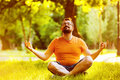 Portrait of happy meditating man with beard in a summer park Royalty Free Stock Photo