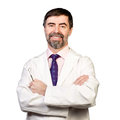 Portrait of happy middle aged dentist isolated on a white wearing lab coat dentist mirror in his hand Stock Photography