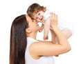 Portrait happy mom and baby on a white background, family, tenderness Royalty Free Stock Photo