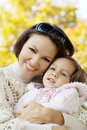 Portrait of a happy mom and a little girl in the autumn Stock Photography