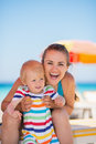 Portrait of happy mother and baby on beach Royalty Free Stock Photography