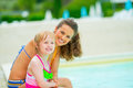 Portrait of happy mother and baby girl near pool Royalty Free Stock Photo