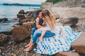 Portrait of happy mother and daughter spending time together on the beach on summer vacation happy family traveling cozy mood Royalty Free Stock Photo