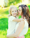 Portrait happy mother hugging child daughter in summer Royalty Free Stock Photo