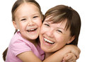 Portrait of a happy mother hugging her daughter Stock Photos