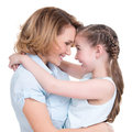 Portrait of happy mother and young daughter look at each other on isolated white background family people concept Stock Images