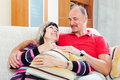 Portrait of happy ordinary mature couple together in home interior Royalty Free Stock Photo