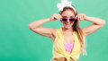 Portrait of happy pin up girl wearing sunglasses. Royalty Free Stock Photo
