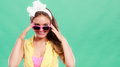Portrait of happy pin up girl wearing sunglasses smiling pretty with hairband bow attractive gorgeous young retro woman posing in Royalty Free Stock Photography