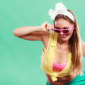 Portrait of happy pin up girl wearing sunglasses smiling pretty with hairband bow attractive gorgeous young retro woman posing in Stock Image