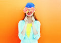 Portrait happy pretty smiling woman and lollipop having fun over colorful orange Royalty Free Stock Photo