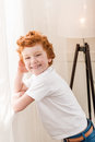 Portrait of happy redhead little boy looking at camera Royalty Free Stock Photo