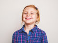 Portrait of happy redhead little girl smiling. Royalty Free Stock Photo