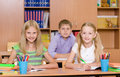 Portrait of happy schoolkids in classroom Royalty Free Stock Photo