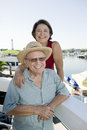 Portrait Of A Happy Senior Couple At Harbor Royalty Free Stock Images