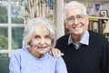 Portrait of happy senior couple at home together smiling Royalty Free Stock Photography