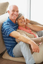 Portrait of a happy senior couple sitting together Royalty Free Stock Photography