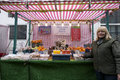 Portrait of a happy senior fruit stall owner standing in market Royalty Free Stock Photo