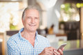 Portrait of happy senior man using mobile phone Royalty Free Stock Photo
