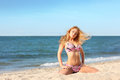 Portrait of happy sexy girl in pink bikini posing against sea Royalty Free Stock Photo