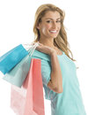 Portrait of happy shopaholic woman carrying shopping bags young isolated over white background Royalty Free Stock Photo