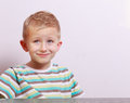 Portrait of happy smiling blond boy child kid at the table cute interior emotions Royalty Free Stock Photos