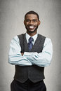 Portrait happy smiling corporate executive closeup handsome young business man with arms crossed confident student agent Stock Images