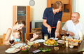 Portrait of happy smiling family communicate over holiday table multigeneration at home interior Royalty Free Stock Photography