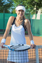 Portrait of Happy Smiling Female Tennis Player at Court Standing Royalty Free Stock Photo