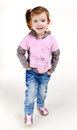 Portrait of happy smiling little girl in jeans Stock Photo