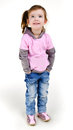 Portrait of happy smiling little girl in jeans Royalty Free Stock Photography