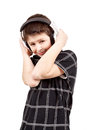 Portrait of a happy smiling young boy listening to music on head headphones against white background Stock Photo