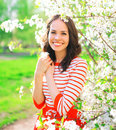 Portrait happy smiling young woman over spring flowers Royalty Free Stock Photo