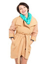 Portrait of happy woman in beige coat with green scarf standing isolated on white background Royalty Free Stock Photo