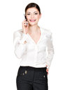 Portrait happy woman calling mobile white shirt isolated white Royalty Free Stock Photos
